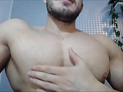 Hot bodybuilder flexes pecs and jerks off