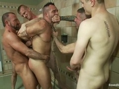 A sexy hunk gets amazingly fucked by his buddies in a bathroom
