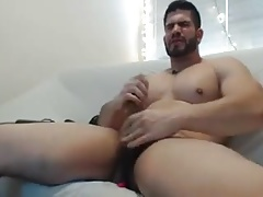 Beefy stud with toys on cam