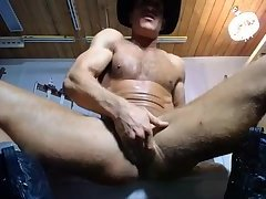 Cowboy sticks toy gun up his ass