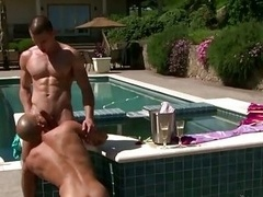 Hungry stud sucking dick outdoors by the pool