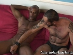 Tattooed queer Tom Colt gives hand to a horny black dude