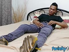 Cute Asian twink Joshua pleasures himself in his bedroom