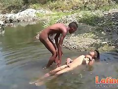 Teen gay swimmer playfully going down in the river