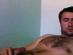 Handsome hairy guy jerking off
