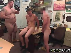 Cute guy is forced to suck two hard dicks to bail out his girlfriend