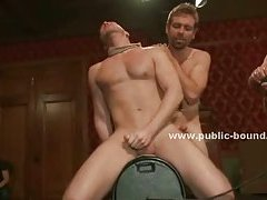 Gay male slave is forced on his feet