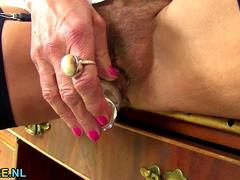 Hairy European granny dildoing her pussy and ass