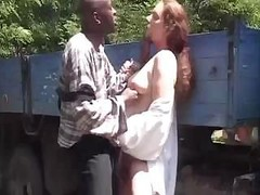 Brunette Jolie has an outdoor make love session with a black love tool