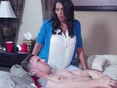 A milf that loves cock is playing with a large dick on the bed