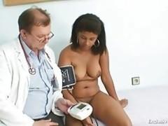Black rotund Manuela gyno exam by white mature doctor