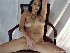 Cute babe masturbates while sitting in a chair