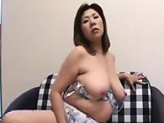 Big tit chubby Asian gal undresses and fingers her clit on