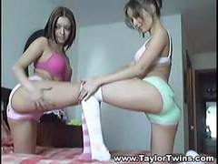 A duo hot lesbo twins perform sexual gymnastics on queen-size bed