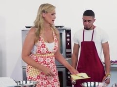 A blonde milf with some huge tits is fucked in the kitchen
