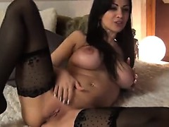 Stunning busty woman teases along with her treats