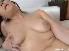 Chubby raven haired amateur cums on a thick black dildo