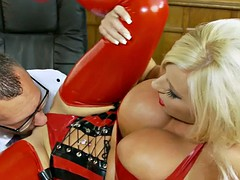 Sexy Michelle in red latex corset has geek lick her pussy