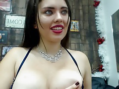 Girl with sparkly necklace milks her tits