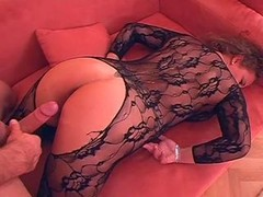 German Wife large breasts in hot Catsuit laid