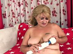 Chubby mom uses magic wand