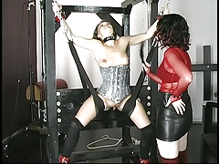 Young pain-loving brunette is bound and whipped by older mistress in dungeon