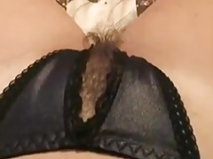 My hairy wet pussy in black panties with a slit.