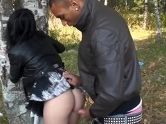 A black haired lady is getting fucked roughly in the forest