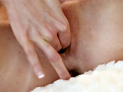 Redhead slut Jenny Blighe plays with her silky pussy