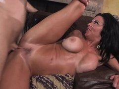 A milf with a wonderful rack is getting fucked in her wet pussy