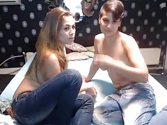 topless women in jeans spit on each other's faces