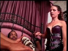 Black guy with large purple pole is pinioned to bed