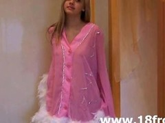 Pink tiny teenager undressing