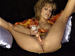 Milf is playing with a funny vibrator