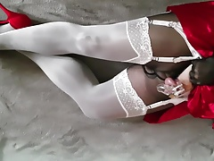 White gloss stockings over pantyhose, heels and chasity