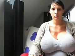 hot brunette hiding her massive boobs clip