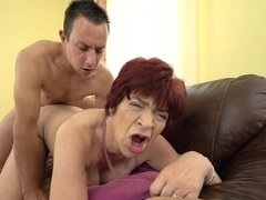 A granny is fucked by her young partner that loves old cunt