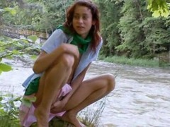 My chick rubbing the button by the river