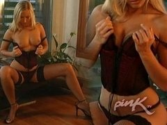 Beautiful blonde jacking off on the sofa