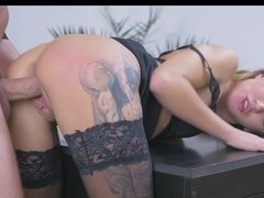 Blonde with tattoos on her ass and legs is fucked doggy style