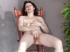 Mature with undersized saggy tits makes herself cum and besides squirt
