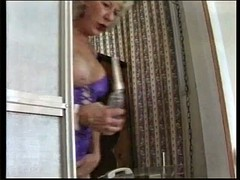 two mature women pee and shower together
