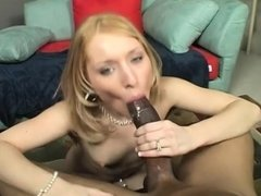 Petite blonde seduces a black man and enjoys the pussy drilling action