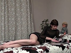 Hairy babe Lia plays with a glistening toy
