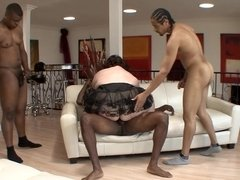 A huge woman is getting fucked by three dudes at once in a foursome