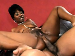 Saucy ebony broad can't help but moan while riding this fat prick