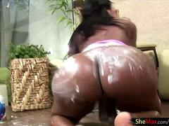 Attractive black shemale tugs and rubs her massive shecock