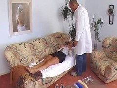 Susana De Garcia is thoroughly inspected by a doctor