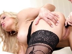A blonde and a brunette use a dildo to explore one another deeply