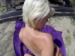A blonde with a pretty pussy is getting her cunt fucked outdoors